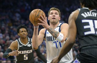 Doncic gets another triple-double as Mavs edge Kings 127-123