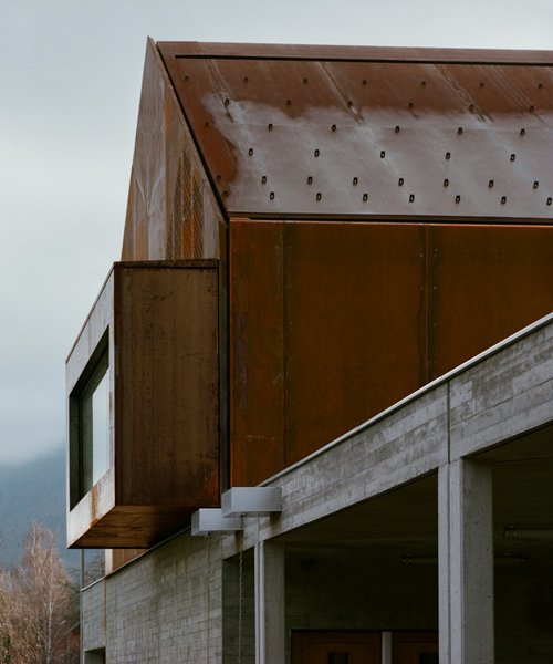 corten steel school in lugrin, france by ateliers o-s architectes overlooks lake geneva