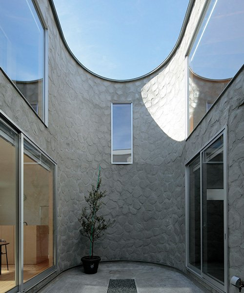 house + dance studio by international royal architecture wraps around open garden in japan