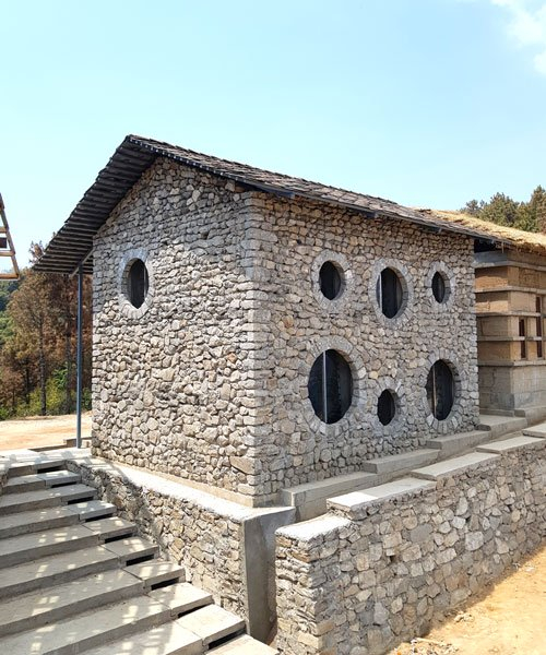 supertecture uses donated bricks from earthquake ruins to extend a school in nepal