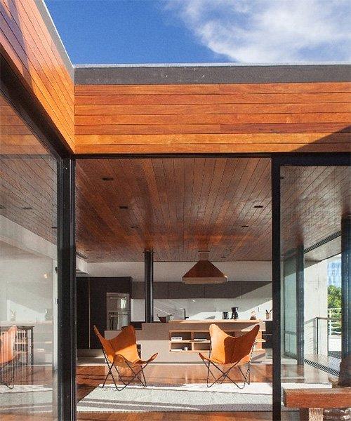 stacked concrete + wooden volumes form pimont arquitetura's 'casa cacupé' in brazil
