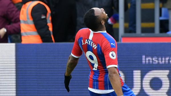Crystal Palace captain Milivojevic and Ghana coach Akonnor react to Jordan Ayew's treble