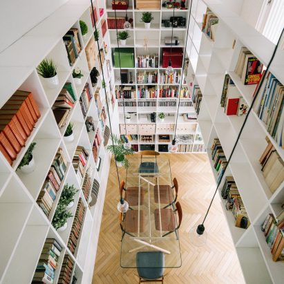 Two-storey bookshelf rises inside renovated Madrid house