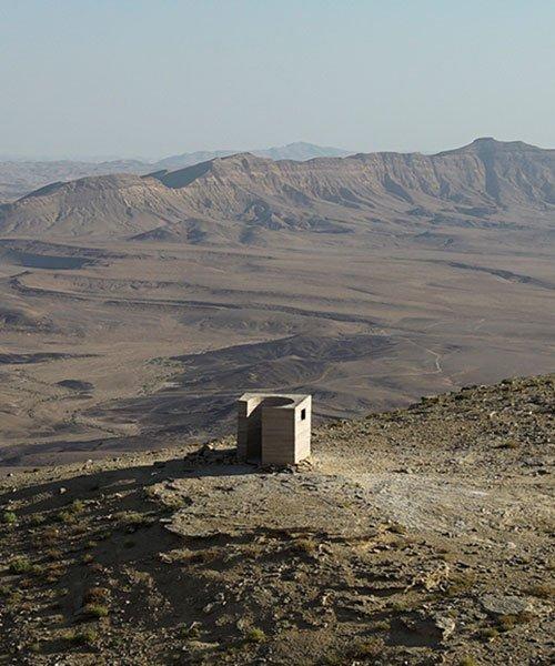sand + rocks form 'landroom' observatory overlooking world's largest erosion crater in israel