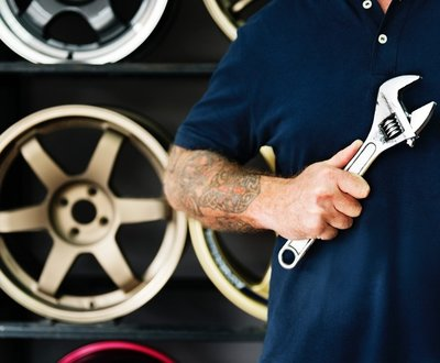 Car mechanic holding a wrench image