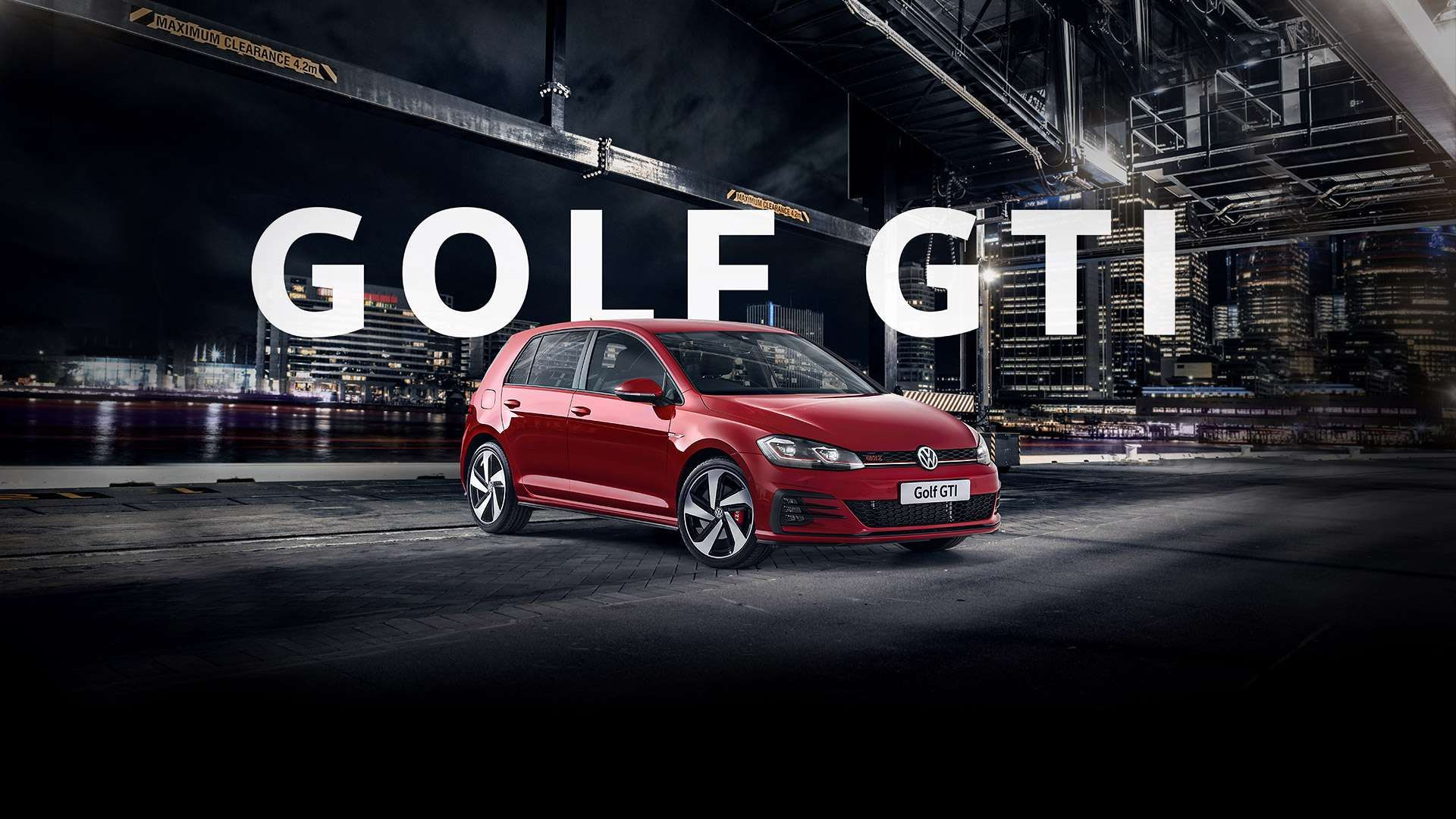 Tornado Red Golf GTI getting into the parking at night