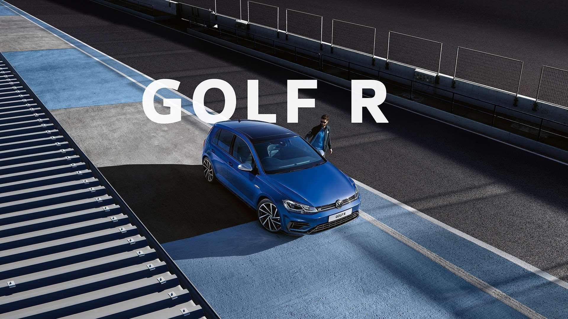 Lapiz Blue metallic Golf R parked by a man. a man