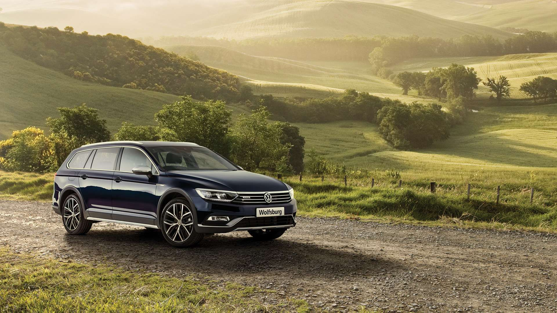 Atlantic Blue Metallic Passat Alltrack Wolfsburg Parked on mountains