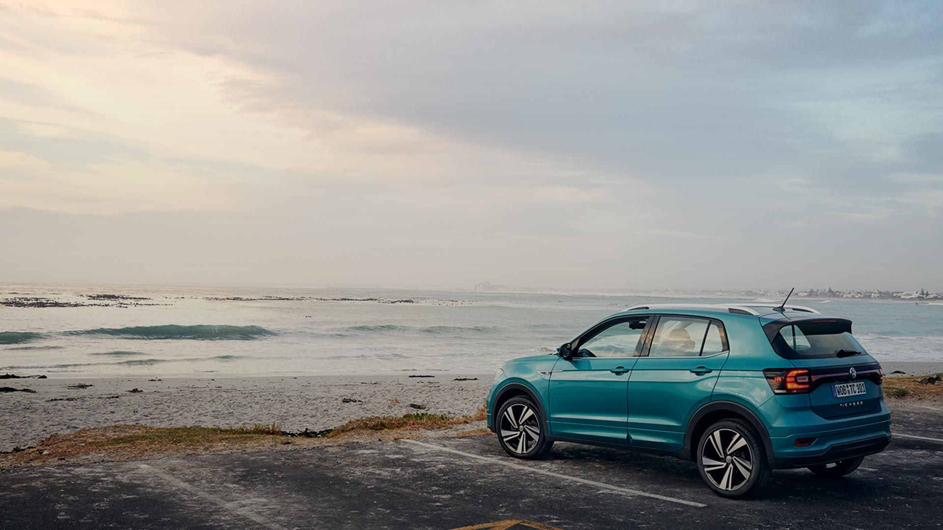 Turquoise T-cross standing near beach