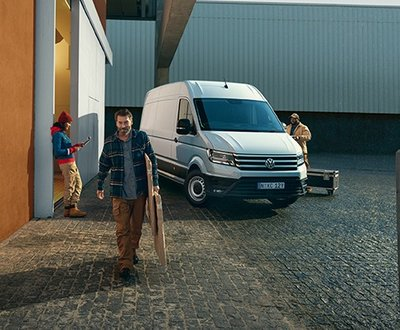 Man with a Crafter Van in the background image