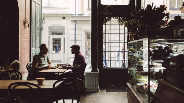 Two People At A Cafe