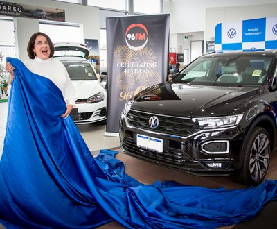 Kim Smith unveils her new car from underneath its blue silk shroud image