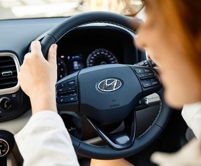 Close up of hands on steering wheel image