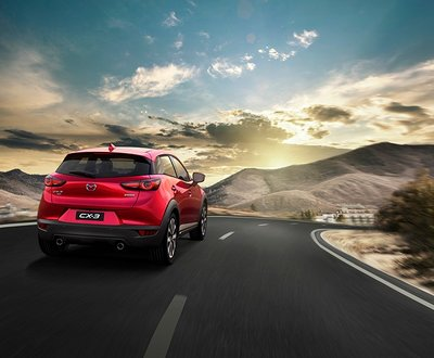 Red Mazda CX-3 Driving Vision from Behind  image