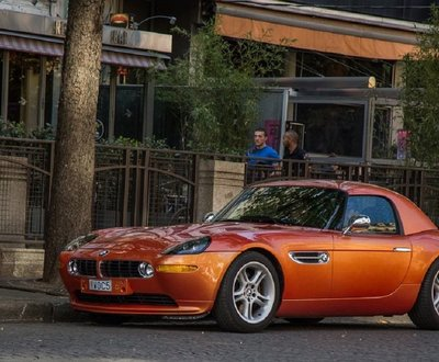 Orange BMW Z8 parked on side of street image