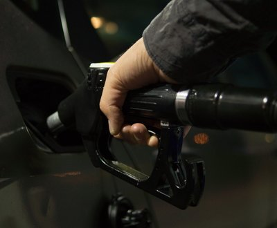 Person filling their car with petrol image
