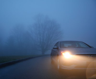 Car driving in wet and dark conditions image