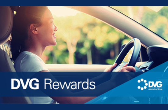 DVG Rewards - Woman in car driving and smiling