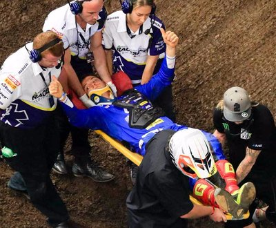 Mitch Evans being stretchered out of the arena image