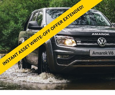 Black Amarok driving through water image