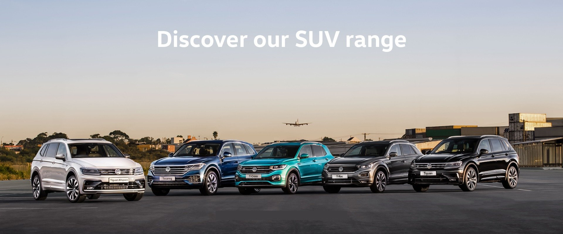 Range of Volkswagen SUVs sitting on an airport runway