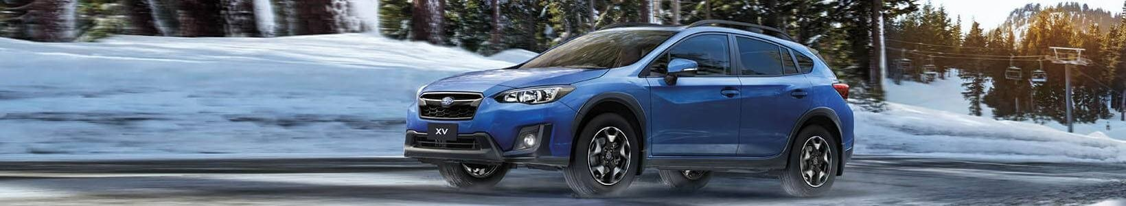 Subaru XV 2017 driving across road
