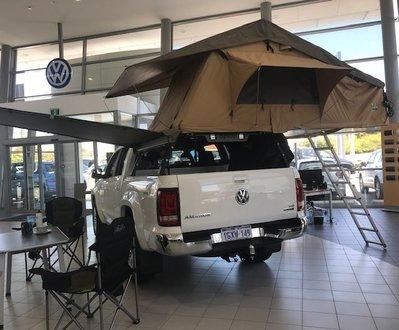 Luxury rooftop tent on a Volkswagen Amarok in the showroom image