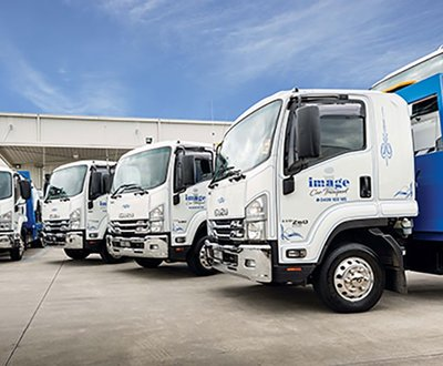 Isuzu projects the ideal image for car transport company.  image