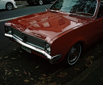 Red Holden Monaro parked on side of Sydney street image