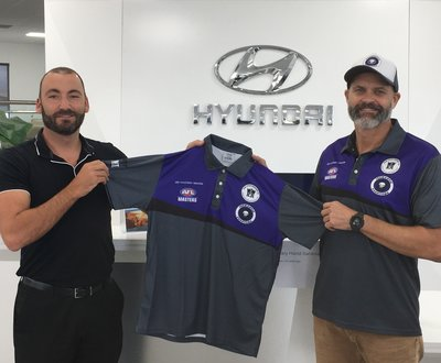 Melville Hyundai Dealer Principal Karl Divirgilio (left) receiving his branded polo shirt from the Club's Vice-President Stuart Wild  image
