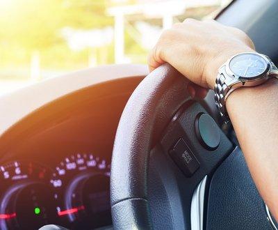 Young man driving car image