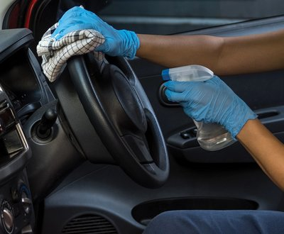 Steering wheel being disinfected image