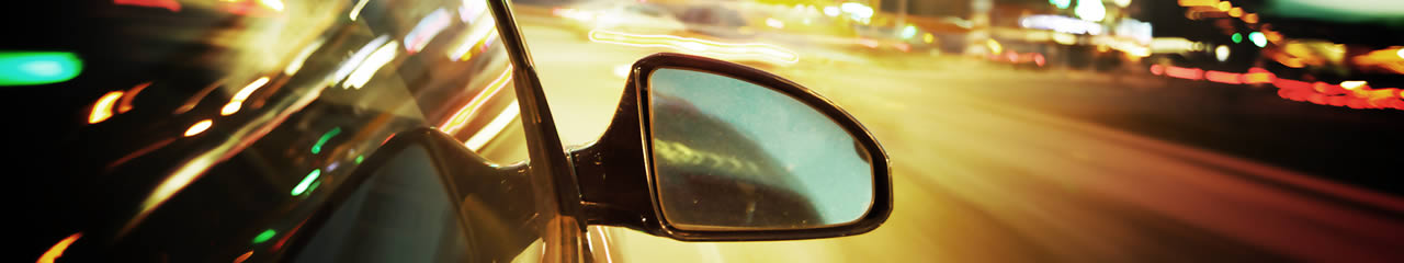 Page Banner - Rear Vision Mirror with Blurry Traffic