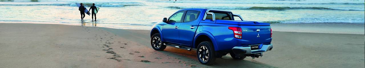 Mitsubishi Triton on the beach