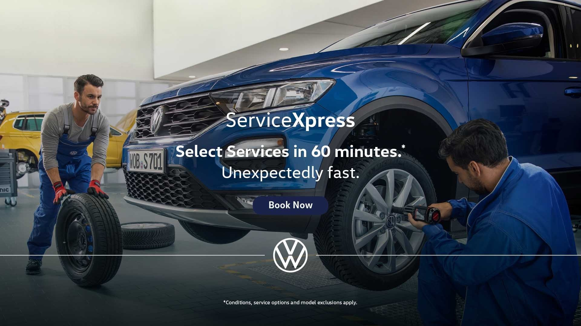 Service Xpress mechanic checking under the bonnet