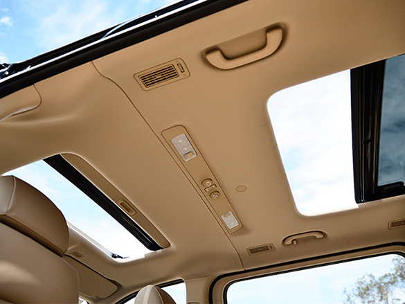 Glass sunroof with blind.