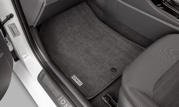 Tailored carpet floor mats.