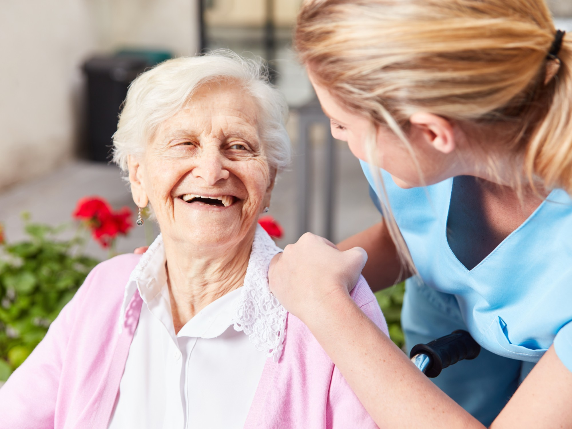 Older women receiving care and happy about it