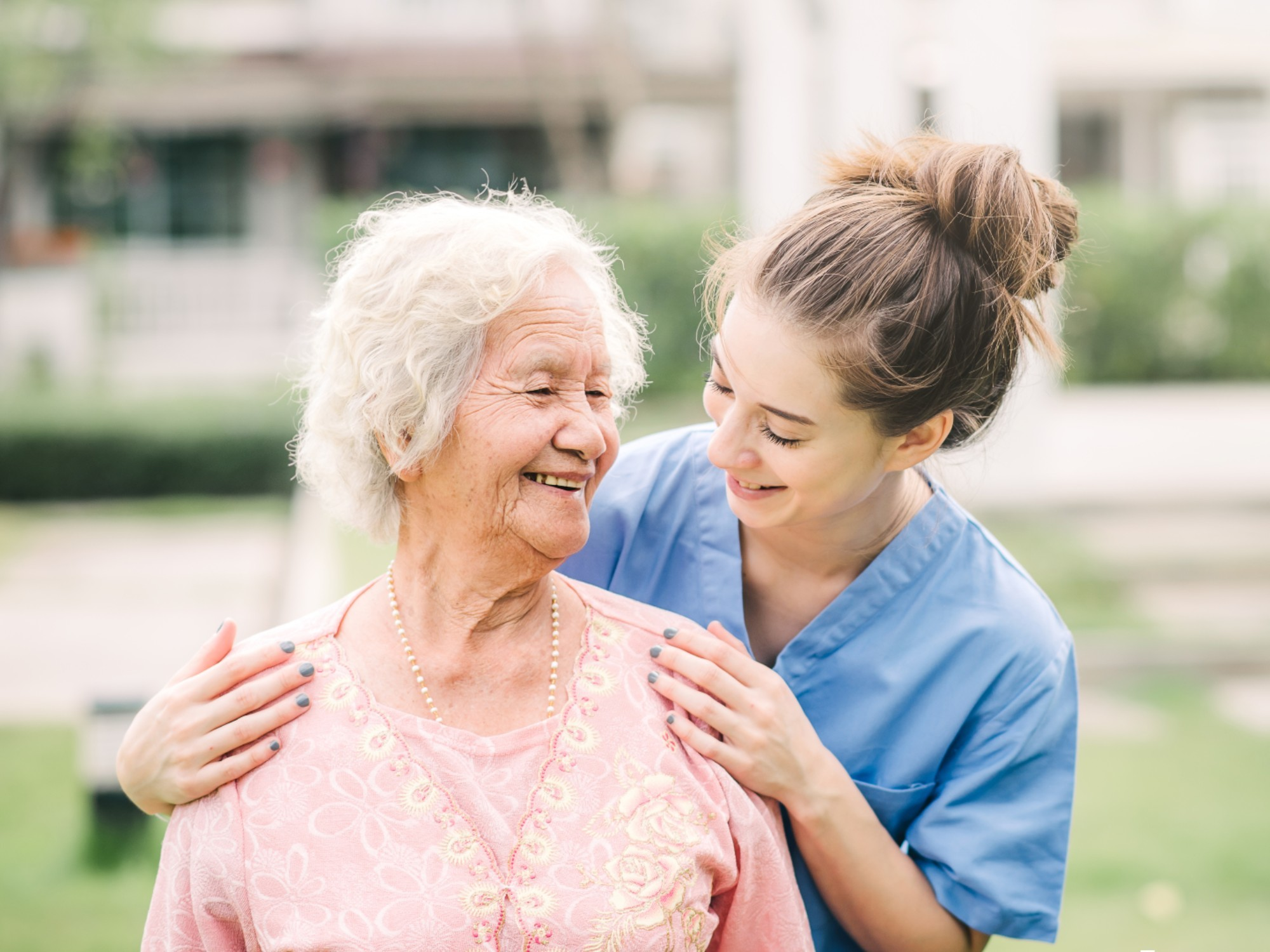 Older woman with an aged care support worker.
