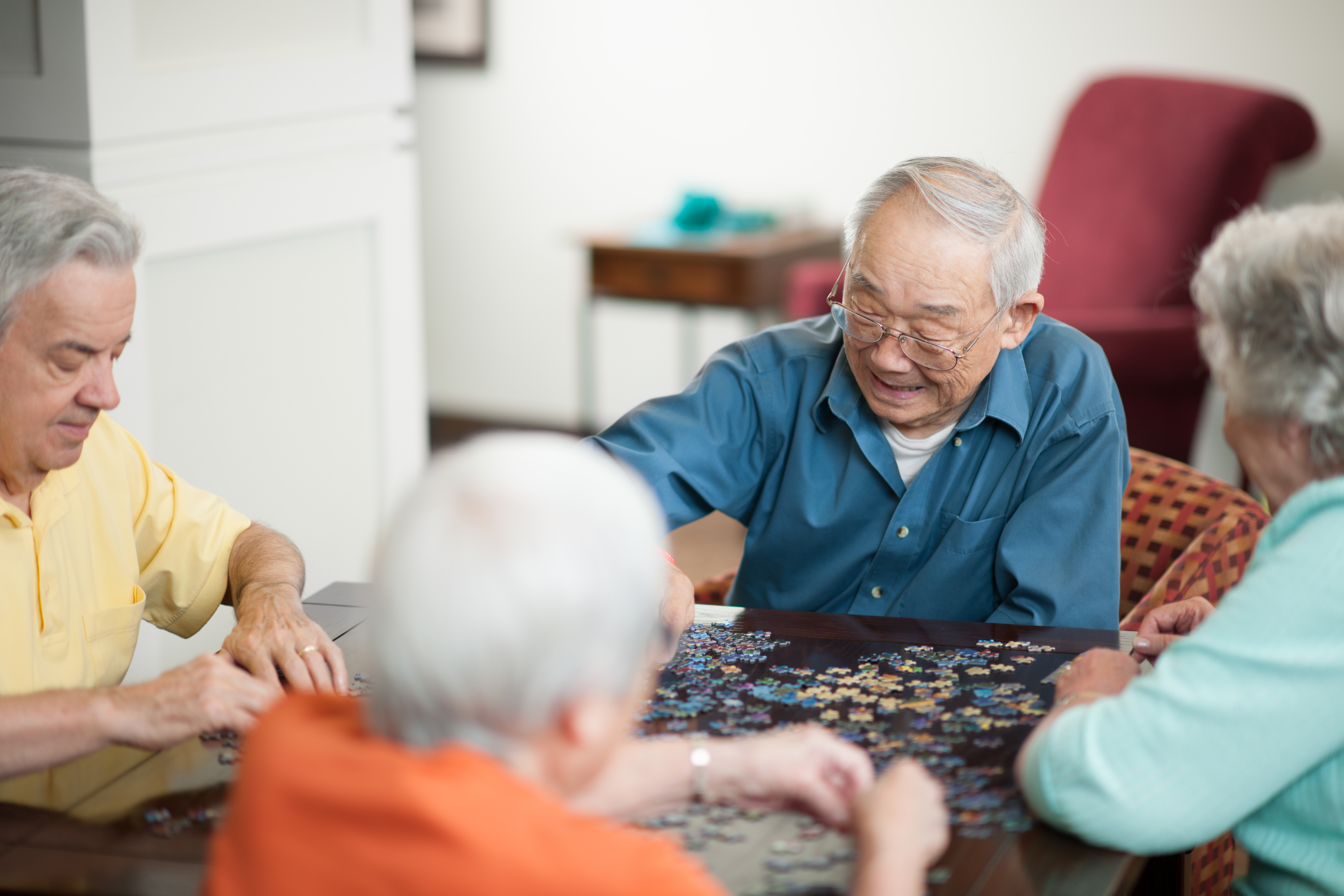 Group of older people doing a puzzle together