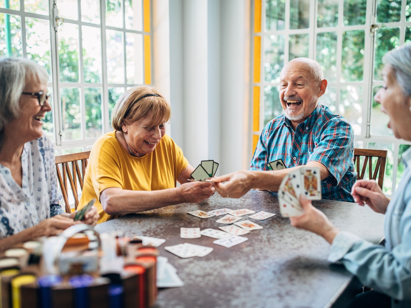 Group of retirees playing cards