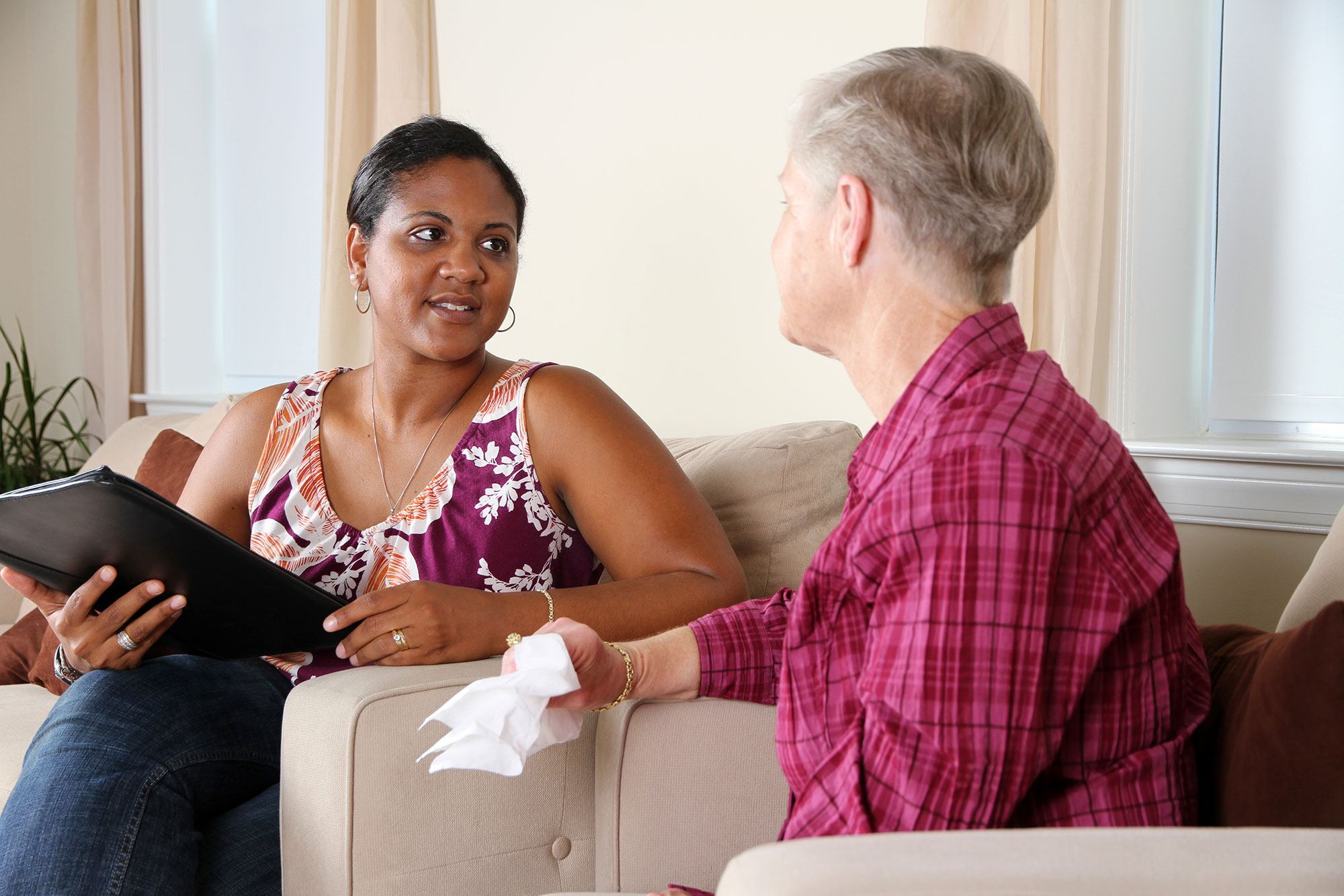 Older woman talking with a placement consultant.