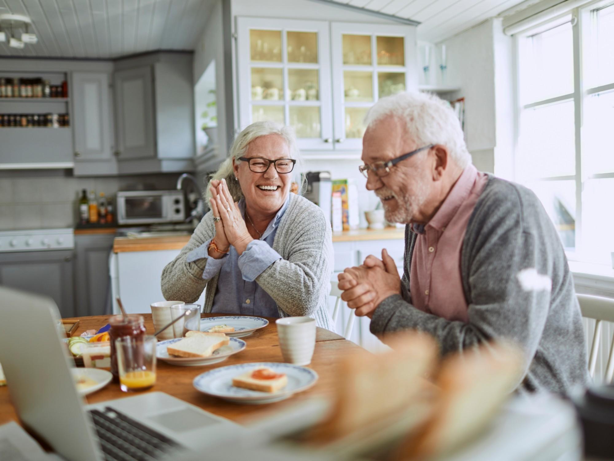 Elderly couple enjoying food at the table