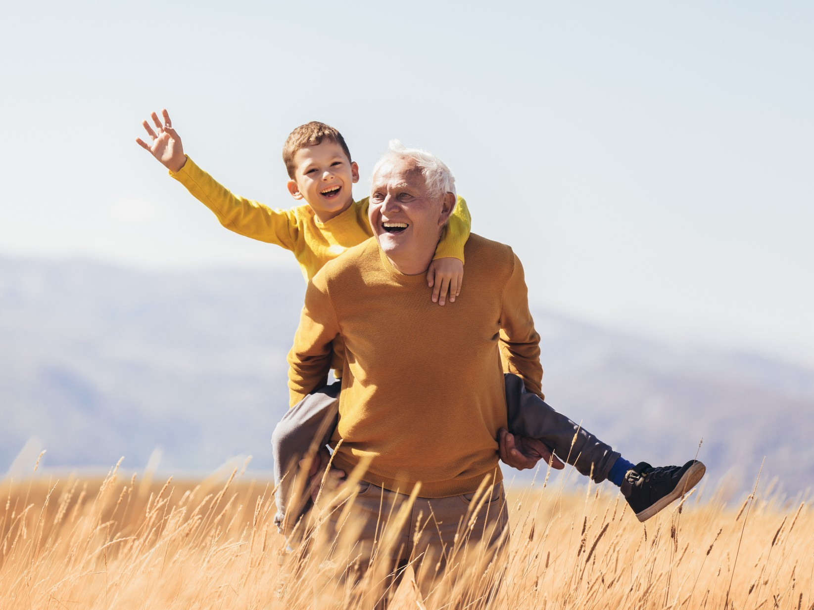 Grandfather going for a hike with his grandson.
