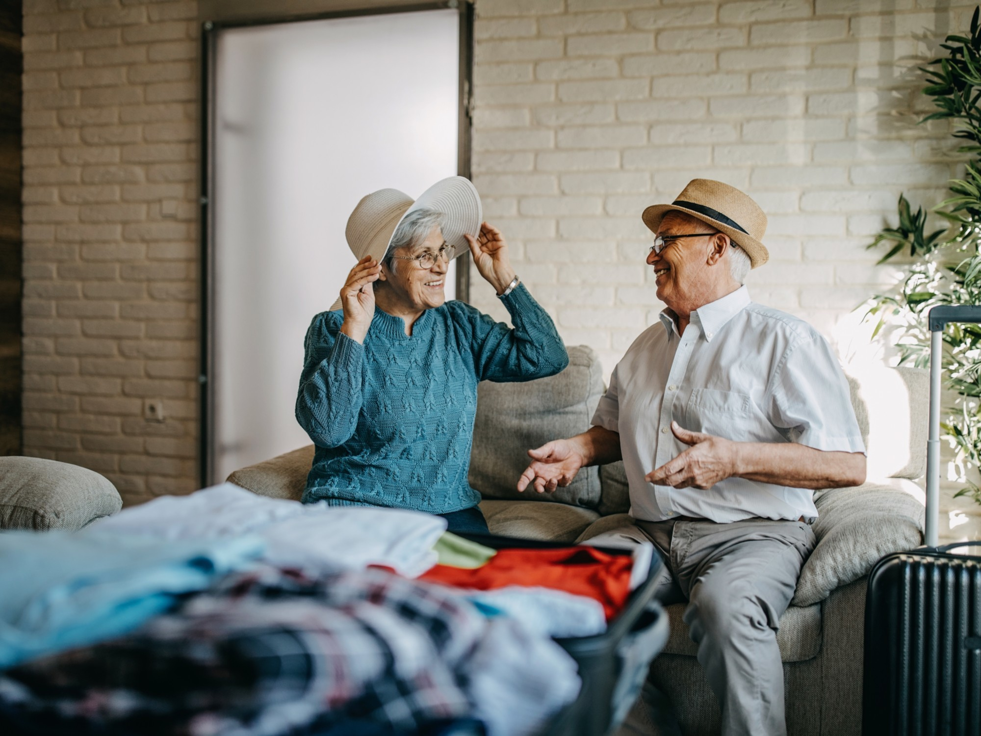 Older couple packing for a vacation