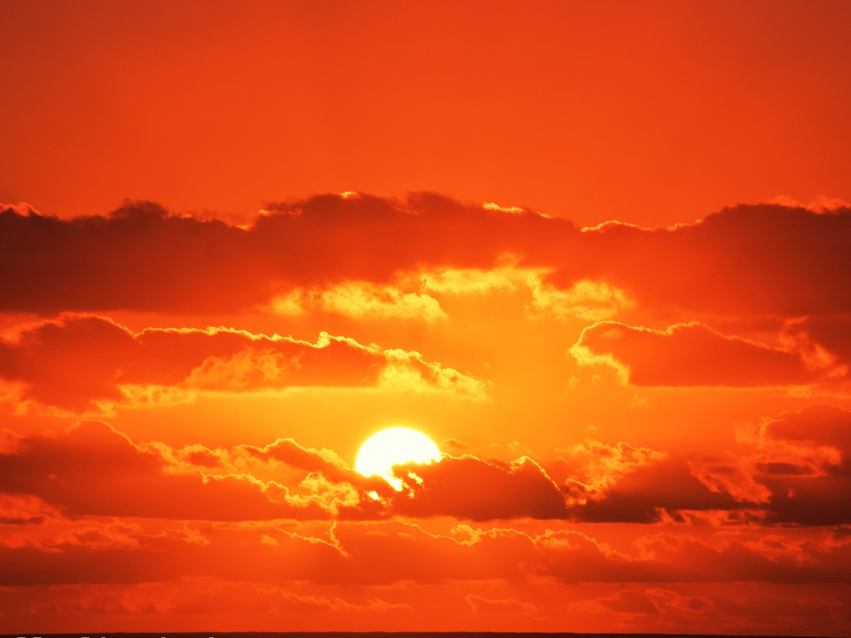 A photo of a very red sunset.