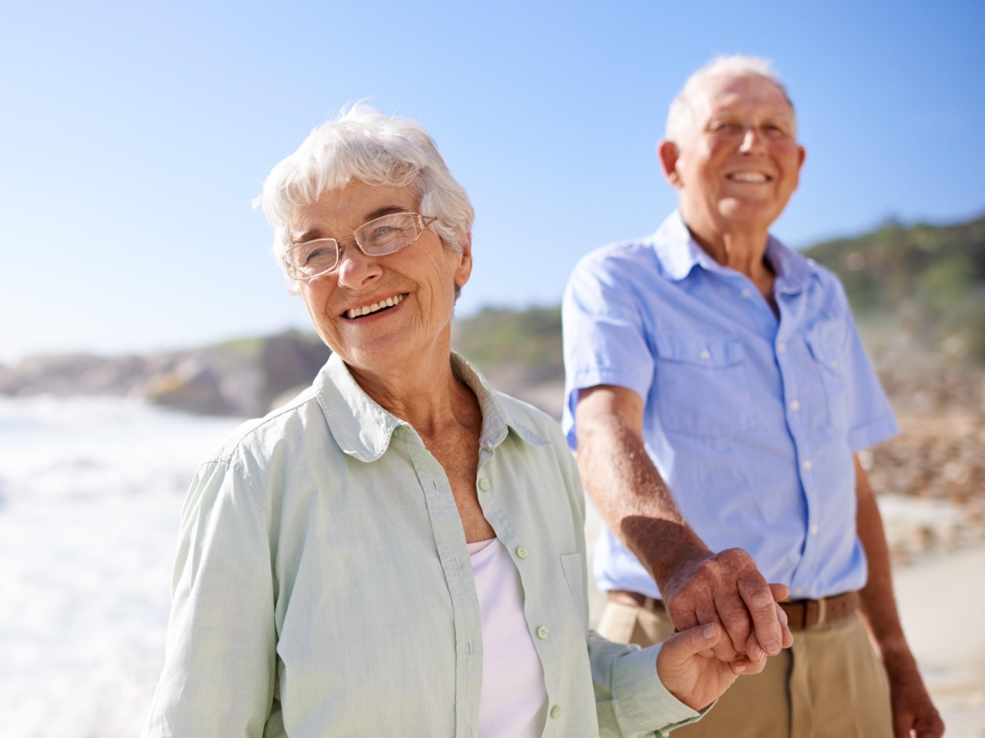 Older couple enjoying themselves on the beach