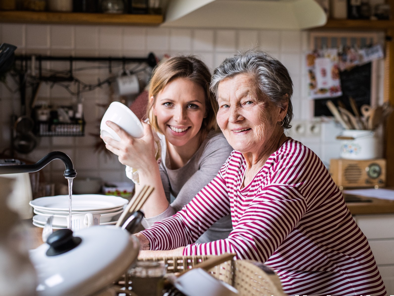 Older woman receiving assistance at home