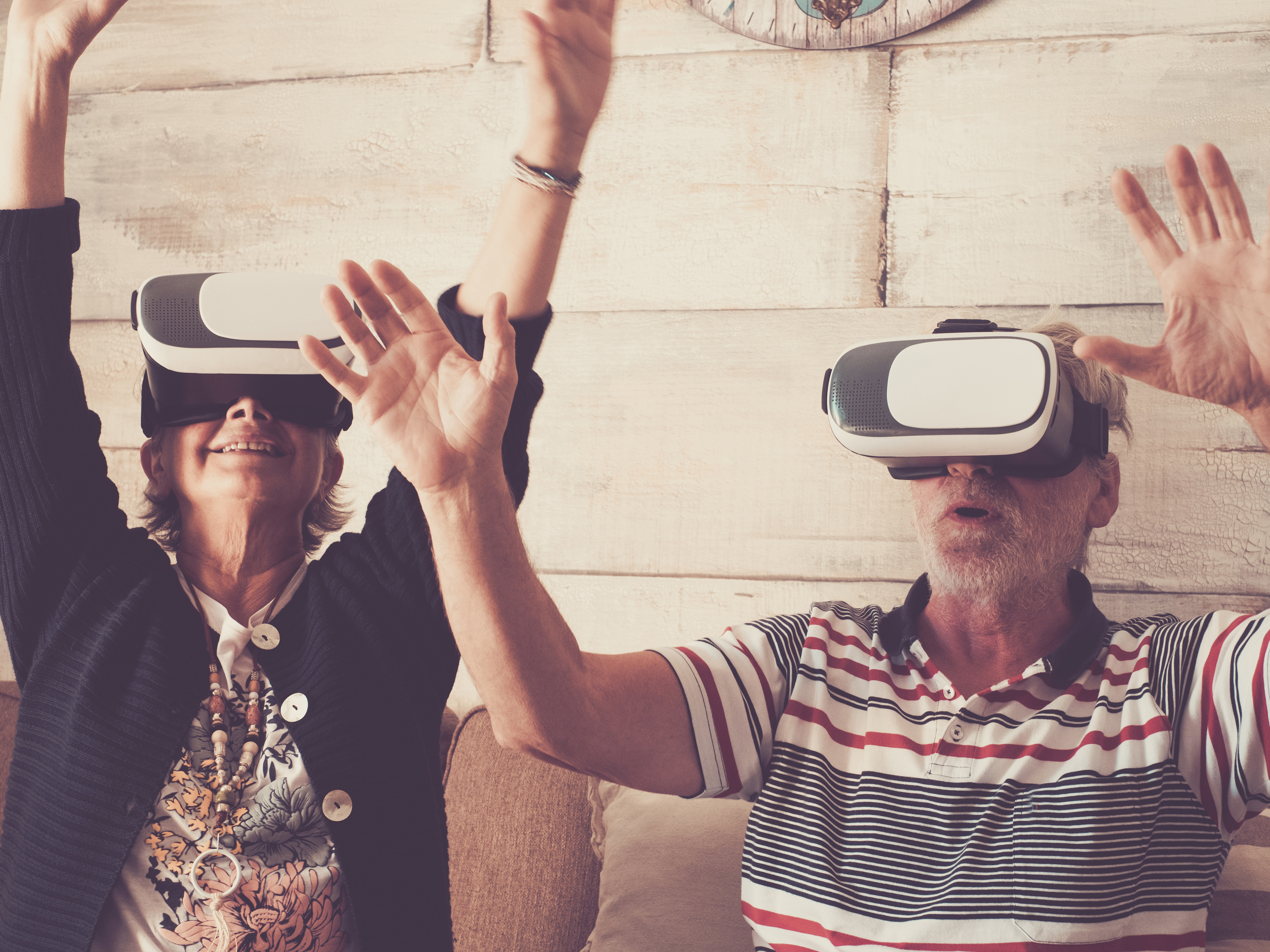 An older couple are experiencing the wonders of virtual reality.