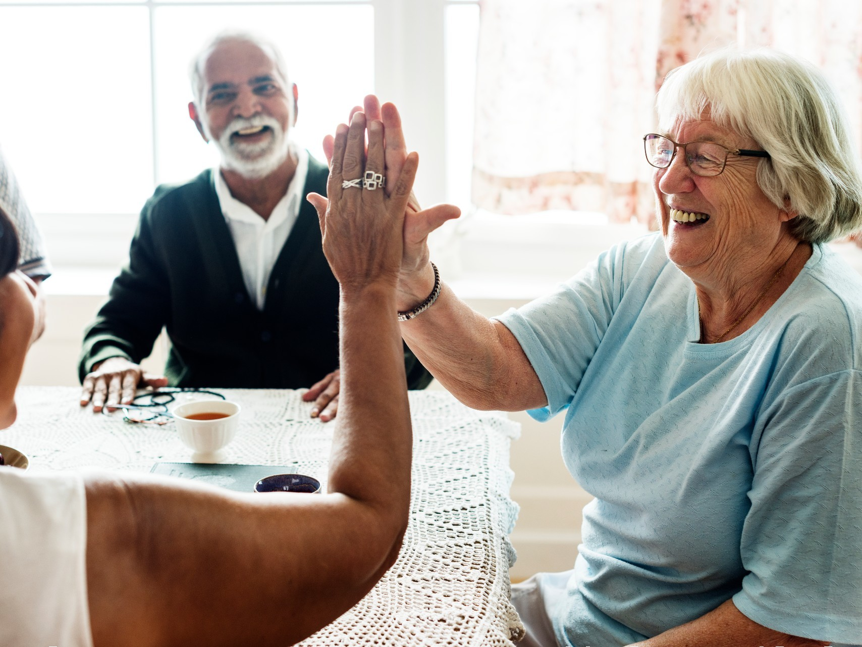Two older people enjoying themselves with a carer